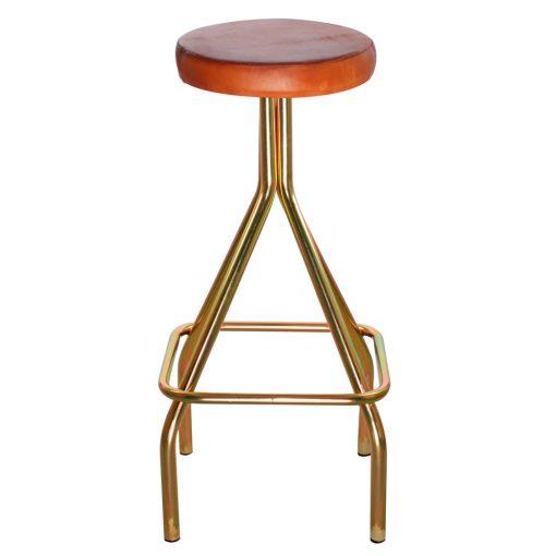 GAUCHO GOLD Tabouret haut pour bar ou table haute de caféteria ou restaurant. Fabriqué en fer, finition doré zinc et assise en cuir. Personnalisable avec un supplément.